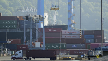 Chinese containers are moved by crane at the Port of Tacoma in Tacoma, Washington state, US.