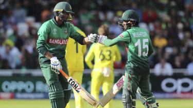 Bangladesh's Mushfiqur Rahim, right, and teammate Mahmudullah congratulate each other.