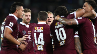 Daly Cherry-Evans and the Maroons celebrate after Cam Munster's decisive try.