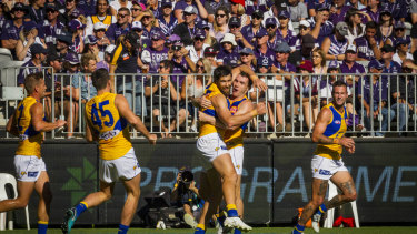 Purple pain: Dockers fans look on as West Coast players celebrate a goal during the Western Derby.