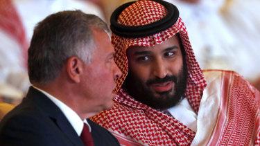 Jordan's King Abdullah II, left, listens to Saudi Crown Prince Mohammed bin Salman.