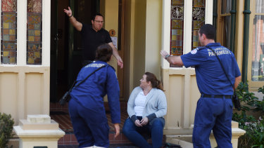 A volunteer imitates an angry person while NSW paramedics assist another volunteer posing as a patient.