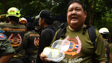 A members of a Thai rescue team holds goggles which will be delivered to the trapped boys.