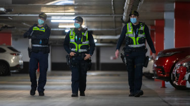 Police patrolling an underground car park in Melbourne's CBD.