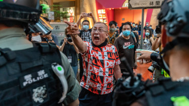 A pro-democracy supporter shouts at riot police during an anti-national security law rally in Mong Kok district on June 12.