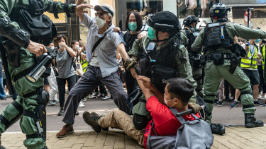 Pro-democracy supporters scuffle with riot police during a rally in Hong Kong.