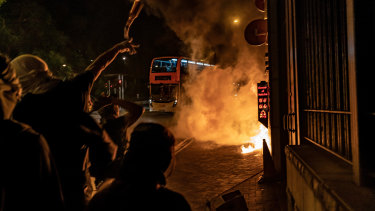 Pro-democracy protesters throw Molotov cocktails at a police station In Tuen Wan district in Hong Kong, China.