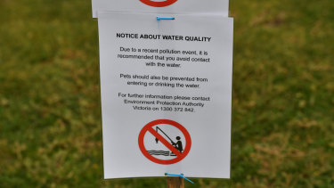 Melbourne Water employees put up warning signs at the Warmies around 5pm.