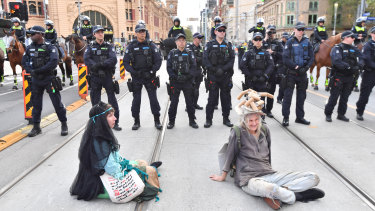 Extinction Rebellion protesters block Flinders Street.