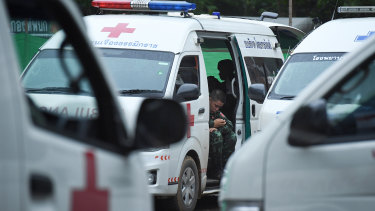 A Thai army medic sits in an ambulance on standby for the rescue operation in a restricted area near Tham Luang cave.
