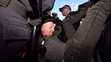Police remove a protester.