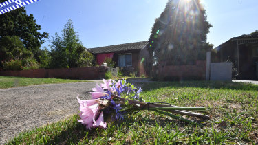 Flowers left at the scene in Heidelberg West where a woman was found dead in her home.