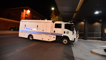 A Victoria Police prisoner transport truck believed to be carrying Ricardo Barbaro arrives at Melbourne West police station on Friday night.