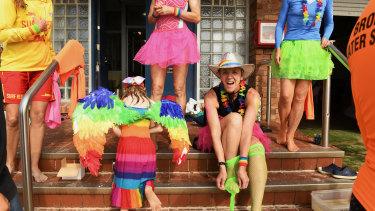 Lifesavers With Pride get into the Mardi Gras spirit at Bronte Beach on Sunday.