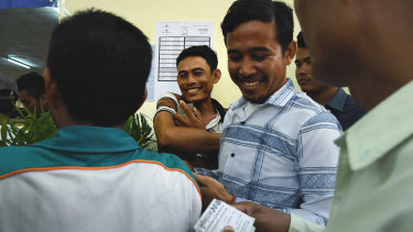 Cambodian voters queue at the Kandal Provincial Teacher Training School in Takhmao.