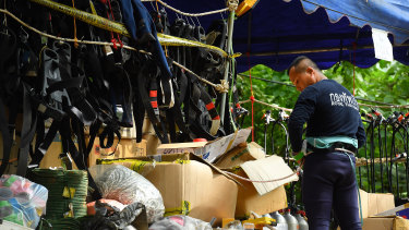 A Thai Navy diver prepares his equipment at the base camp at Tham Luang cave after a diver has died overnight.