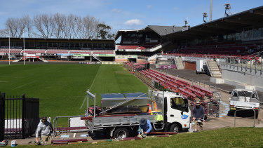 Tradesmen at work at Brookvale Oval after traces of asbestos were found at the Sea Eagles' home.  The ground was given the all-clear by the NRL on Monday night.