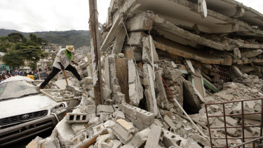 People work to free trapped victims after an earthquake in Port-au-Prince, Haiti, in 2010.