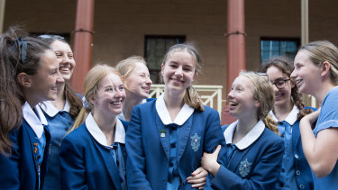Sophia Skarparis, surrounded by classmates from Monte Sant'Angelo Mercy College, after watching state parliament debate her petition  to ban single-use plastic bags.