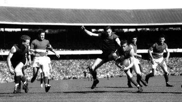 Footscray steal the ball from Barassi.