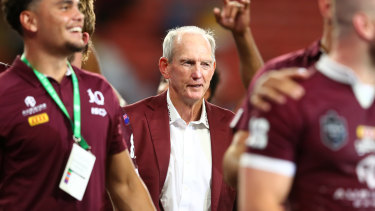 A contented Wayne Bennett looks on as the Maroons celebrate a famous victory.