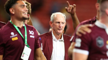 A contented Wayne Bennett looks on as the Maroons celebrate a famous victory in 2020.