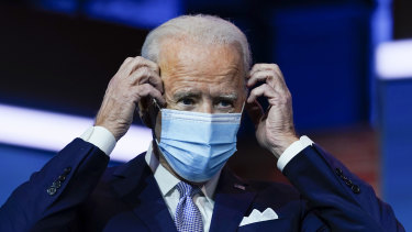President-elect Joe Biden puts on his face mask after a press conference on Tuesday.