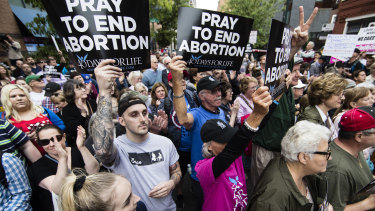 Anti-abortion protesters rally near a Planned Parenthood clinic in Philadelphia after a Democratic state lawmaker berated an anti-abortion demonstrator outside the clinic.