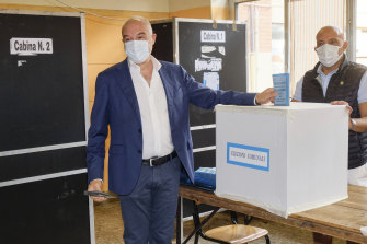 Right-wing candidate Enrico Michetti casts his ballot at a polling station, in Rome.