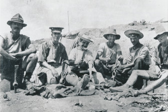 Men of the 8th Battalion in an abandoned Turkish position on Bolton's Ridge.