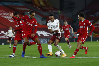 The Reds' defence puts Pierre-Emerick Aubameyang under pressure.