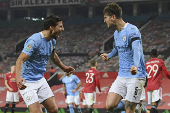 John Stones, right, celebrates scoring the opener for City at Old Trafford.