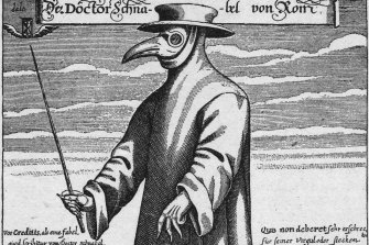 A 17th-century plague doctor in protective gear.