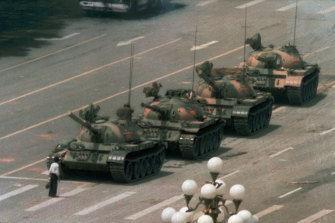 The famous 1989 picture of an unknown Chinese man standing alone to block a line of tanks heading east on Beijing's Changan Boulevard in Tiananmen Square.