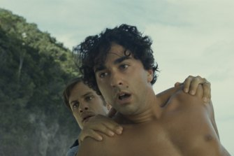 From left: Guy (Gael García Bernal) and Trent (Alex Wolff) in <i>Old<i>.