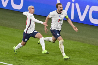 Phil Foden (left) and Harry Kane celebrate the latter's decisive goal at Wembley.