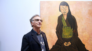 The winner of the 2019 Archibald Prize, Tony Costa, with his portrait of artist Lindy Lee.