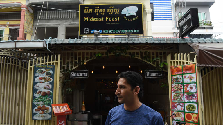 Abdullah in front of his restaurant, Middle East Feast, in Phnom Penh.