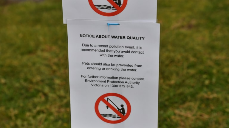 Melbourne Water employees put up warning signs at the Warmies around 5pm on Friday.