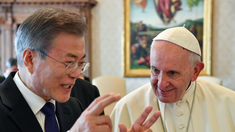 South Korean President Moon Jae-in, left, talks with Pope Francis during their private audience, at the Vatican, on Thursday.