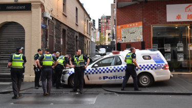Police investigate the scene where Ms Angok's body was found on Celestial Avenue in the CBD on Wednesday.
