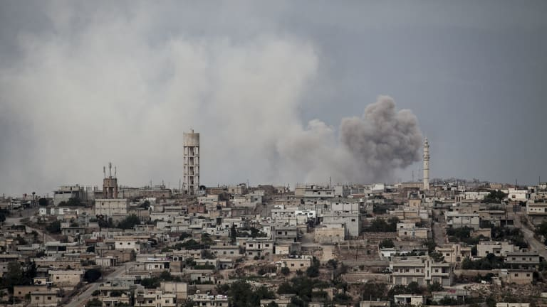 Smoke rises after a bomb hit  a rebel position during heavy fighting in the Idlib province, Syria.