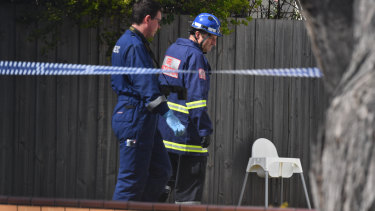 Firefighters outside of the home where the children died.