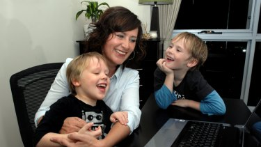 Laurie McDonald in 2009 with her sons Bailey, then four, and Connor, then six, when she won the ACT Business Woman of the Year award.