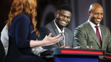 Zion Williamson (centre) is interviewed on ESPN at NBA draft lottery.