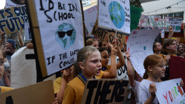 School children at a climate change protest near the office of Tony Abbott in Manly.