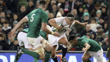 Brute force: Jamie George runs at Ireland's Conor Murray and James Ryan.