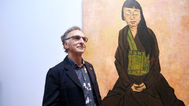 Tony Costa with his portrait of artist Lindy Lee.