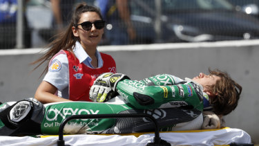 Moto2 rider Remy Gardner is carried off on a stretcher after a crash in Spain.