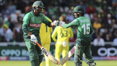 Bangladesh's Mushfiqur Rahim, right, and teammate Mahmudullah congratulate each other.